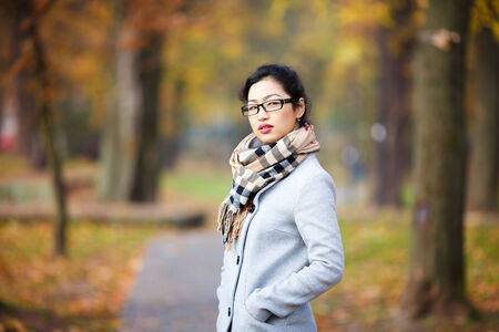 vision repair: beautiful girl in glasses in autumn with yellow background