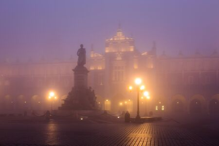 polska: Market square in Krakow at morning fog, Poland Stock Photo