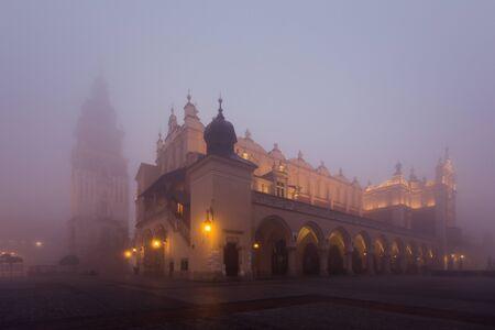 Market square in Krakow at morning fog, Poland photo
