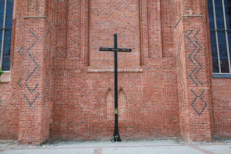 st  nicholas cathedral: Cross near St. Nicholas Cathedral in Elblag, Poland Stock Photo