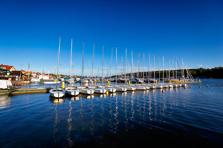 Mikolajki, Masuria, Poland, June 12 2014: Port in Mikolajki at summer sunny day, the Masurian Lakes district in Northern Poland Publikacyjne