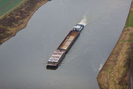 Barge floating on the Elbe river in Swiss Saxony, Germany photo