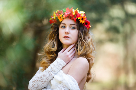 Portrait of a beautiful girl with flowers in her hair at spring time photo