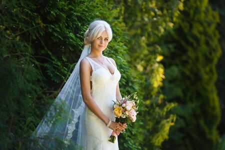 wedding gown: Portrait of beautiful bride in a forest Stock Photo