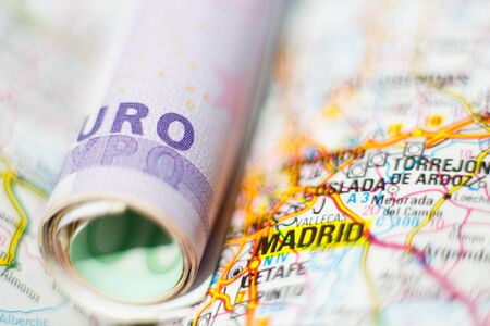 geographical: Euro banknotes on a geographical map of Madrid, Spain Stock Photo