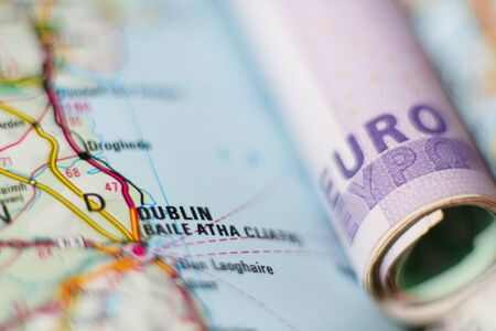 geographical: Euro banknotes on a geographical map of Dublin, Ireland