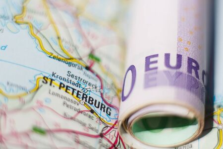 geographical: Euro banknotes on a geographical map of Saint Petersburg, Russia