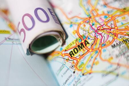 geographical: Euro banknotes on a geographical map of Roma, Italy