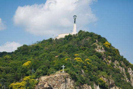 Statue of Liberty on Gellert hill in Budapest at summer day