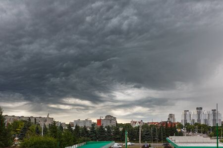 lurid: Kaliningrad, Russia, July 8 2015: Dark clouds asperatus before the storm over city