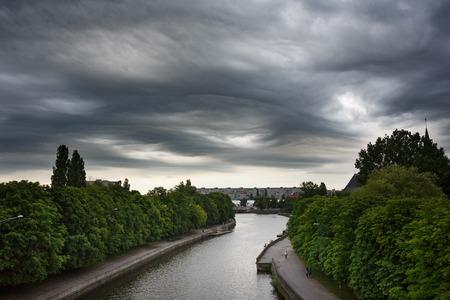 dark clouds: Dark clouds asperatus before the storm over city Stock Photo