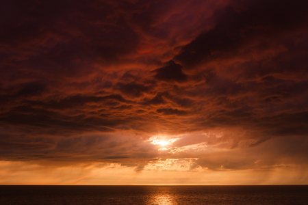 thundercloud: Thundercloud on the background of sunset over the Baltic Sea