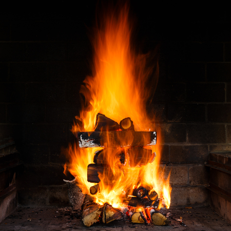 wood burning stove: Burning wood in the stove at night time Stock Photo