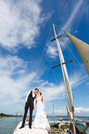 newlywed couple: Wedding couple kissing on a yacht at the summer time