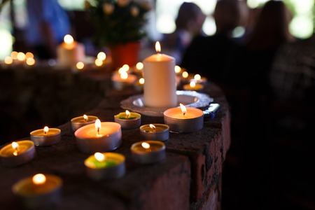 cemeteries: Flaming candles at the funeral ceremony indoor Stock Photo