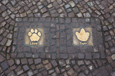 attractiveness: Leipzig, Germany - January 07 2015: Sign on a pavement of the Leipzig Zoo at winter time Stock Photo