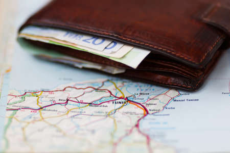 banking concept: Euro banknotes inside wallet on a geographical map of Tunis, Tunis Stock Photo