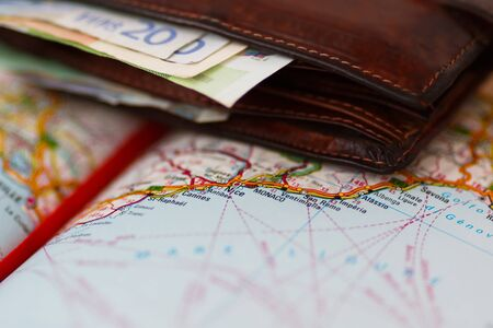geographical: Euro banknotes inside wallet on a geographical map of Monaco, France