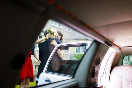 view through door: Embracing view of the newlyweds through a car door