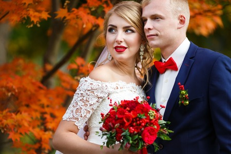 Portrait of the wedding couple in fall Stock Photo