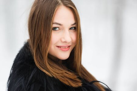 one female: Portrait of a young woman at winter time Stock Photo