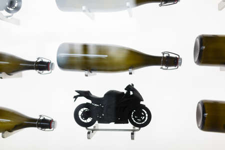 beverage display: Silhouettes of bottle and motobikes on the wall in cafe