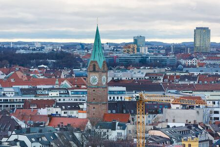 evening church: Munich, Germany - January 04 2016: View of the Holy Cross Church from tower of St.Peter Church, evening time Editorial