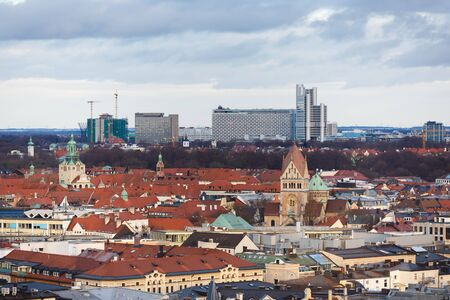 evening church: Munich, Germany - January 04 2016: View of cityscape from tower of St.Peter Church, evening time