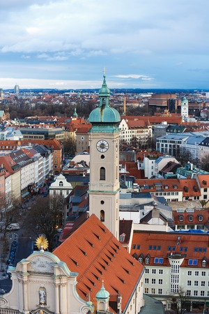 heist: Munich, Germany - January 04 2016: View of the tower of Heilig Heist Church from tower of St.Peter Church, evening time Editorial