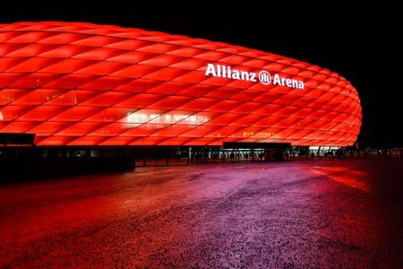 Munich, Germany - January 05 2016: View of the red color Allianz Arena at night time, is a great football stadium in the city with a 75,024 seating capacity Publikacyjne