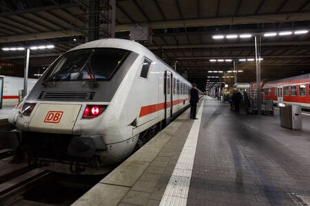railroad station platform: Munich, Germany - January 05 2016: View of the train on platform in Central Railroad Station of Munich
