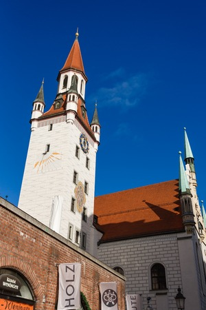 cityhall: Munich, Germany - January 08 2016: The tower of old Cityhall on the blue sky background Editorial