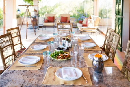 spanish home: Set the table before the lunch in veranda of the Spanish home, Mallorca