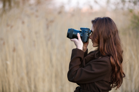 camera girl: Portrait of attractive teenage girl with camera