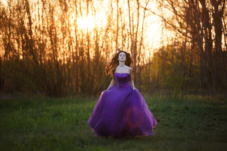 evening gown: Running attractive girl dressed evening gown at sunset