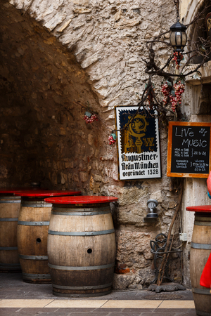 near beer: Garda, Italy - May 03 2016: Beer barrels near the old beer restaurant in the old town Editorial