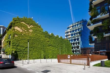 bosco: Milan, Italy - May 04 2016: The green wall of building nearby the Bosco Verticale in the Porta Nuova area of the city