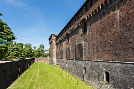 sforza: Milan, Italy - May 04 2016: The brick wall of the Sforza Castle, famous historical attraction of the city, spring time