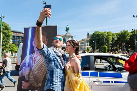 starwars: Milan, Italy - May 04 2016: Couple of young people makes selfie during the parade of costumed Star Wars on the street of Luca Beltrami Editorial