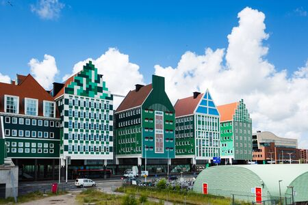 zaandam: Zaandam, Netherlands - July 02 2016: Some people at the Zaandam Central Railroad Station, famous building of traditional architecture in Dutch region