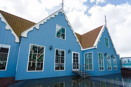 zaandam: Zaandam, Netherlands - July 02 2016: The buildings of traditional architecture nearby the Zaandam Central Railroad Station