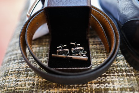 suit  cuff: The stuff of a groom on a chair