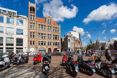 parked bikes: Amsterdam, Netherlands - July 03 2016: Parked bikes on the Koningsplein street, summer time Editorial