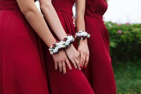 Wedding bracelets on hands of bridesmaids outdoor