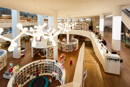 huge: Amsterdam, Netherlands - July 02 2016: Some people visit the Public Library Amsterdam, the best library of Netherlands Editorial