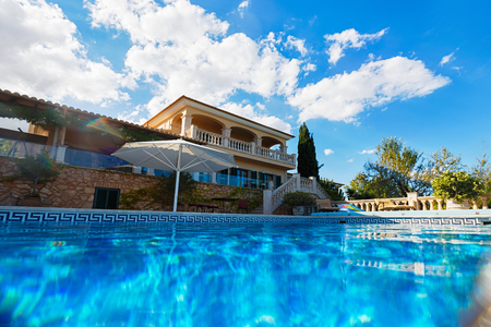 View of the typical Spanish house from the pool, Mallorca Stock Photo