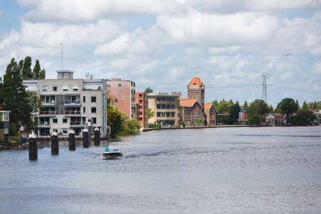 zaandam: Zaandam, Netherlands - July 02 2016: Industrial area on the embankment of the river, summer time