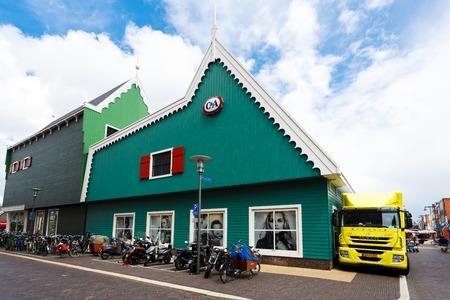 zaandam: Zaandam, Netherlands - July 02 2016: View of the traditional dutch shopping centre on a central street, summer time Editorial