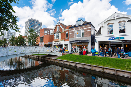 zaandam: Zaandam, Netherlands - July 02 2016: Some people are walking on a central street, build up with traditional Dutch houses Editorial