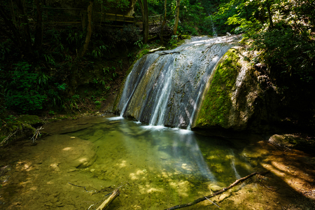 Waterfall in a forest of Molina, Italy